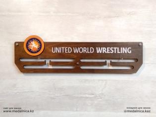 Медальница на заказ Алматы. Доставка по Казахстану. Медальница Union World Wrestling UWW с логотипом.